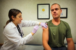 Man receiving flu shot | 2013 Getty Images