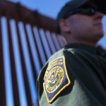 NOGALES, AZ - FEBRUARY 26: A U.S. Border Patrol agent stands at the U.S.-Mexico border fence on February 26, 2013 in Nogales, Arizona. Various federal agencies are tasked with securing the border from drug smugglers and illegal immigration in the Tucson sector of Arizona. (Photo by John Moore/Getty Images)